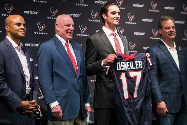 Houston Texans quarterback Brock Osweiler stands with general manager Rick Smith, far left, owner Bob McNair and Cal McNair, far right, as he is introduced during a news conference at NRG Stadium on Thursday, March 10, 2016, in Houston. The Texans introduced four free agent signees Thursday, including Osweiler, running back Lamar Miller, center, Tony Bergstrom and guard Jeff Allen.