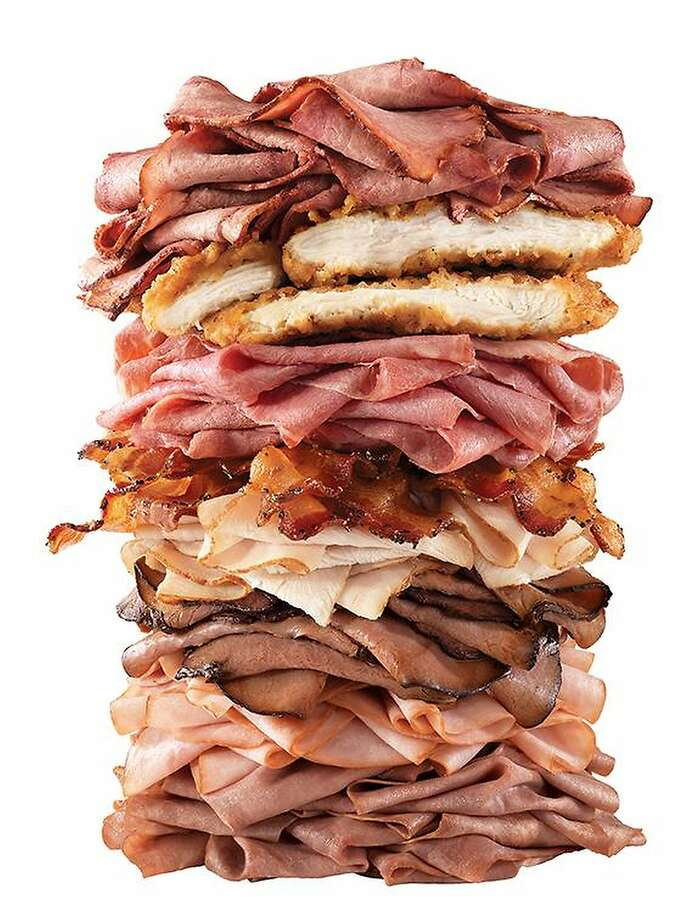 "Arby's Meat MountainFile this monstrosity under ""The customer isn't always right."" Arby's posted a giant stack of various meats in a promotional photo to show that it didn't only serve roast beef. However, customers took the photo as a literal ad for a sandwich. Thus, like an accidental Frankenstein's monster, the Meat Mountain was added to Arby's secret menu. What is a Meat Mountain, exactly? All this lies within the bun: two chicken tenders, ham, roast turkey, brisket, corned beef, angus steak, Swiss cheese, cheddar cheese, and of course, bacon. The defibrillator will be extra. Photo: Arby's"