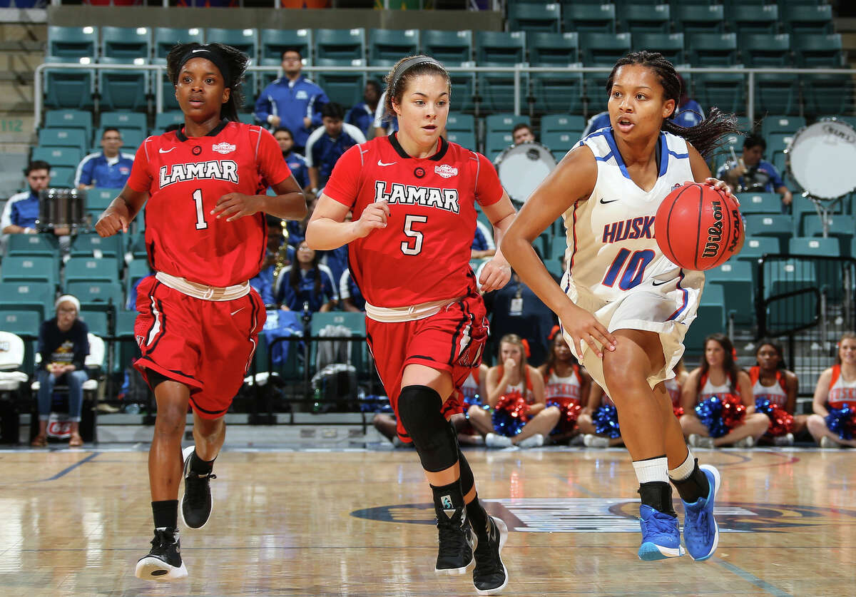 Lamar's Addesha Collins, left, and Baileigh O'Dell, center, chase down Houston Baptist's Bria Johnson during Thursday's Southland Conference Tournament game at the Merrell Center in Katy. Rick Yeatts/Southland Conference