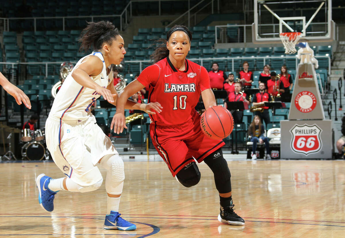 Lamar's Chastadie Barrs drives toward the basket vs. the Houston Baptist defense during Thursday's Southland Conference Tournament game at the Merrell Center in Katy. Rick Yeatts/Southland Conference