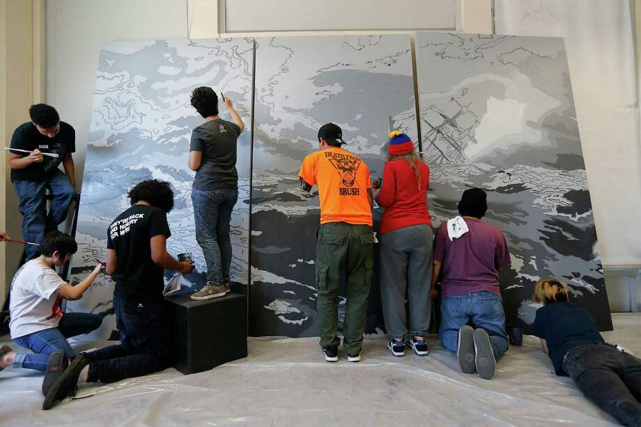 Artists Vincent Valdez and Alex Rubio work with volunteers and students to create a reproduction of a painting by Valdez depicting a ship in stormy seas. It will be placed on display at the Palmetto Center for the Arts at Northwest Vista College. The project was made possible by a grant from the National Endowment for the Arts and with support from Jerry's Artarama according to officials. (Kin Man Hui/San Antonio Express-News) Photo: Kin Man Hui /San Antonio Express-News / ©2016 San Antonio Express-News