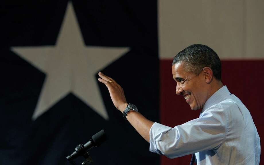 President Barack Obama waves to the crowd as he arrives to speak at a fundraising event at the Austin Music Hall in Austin, Texas, Tuesday, July 17, 2012. Obama is spending the day fundraising in Texas. (AP Photo/Susan Walsh) Photo: Susan Walsh, STF / Associated Press / AP