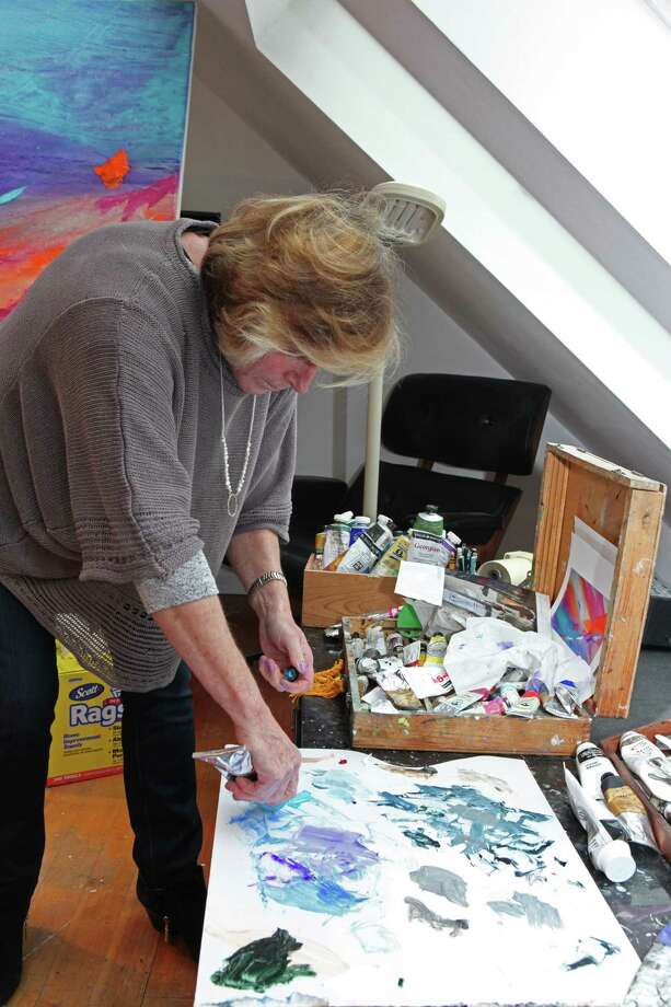 "Stamford artist Lisa Cuscuna in her art studio. ""Painting is an ever-changing new career for me,"" she says. Photo: Contributed Photo"