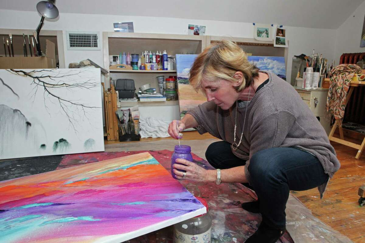 Stamford artist Lisa Cuscuna works in her studio.