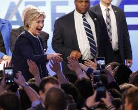 Democratic presidential candidate, Hillary Clinton greets supporters after participating in the Univision, Washington Post Democratic presidential debate at Miami-Dade College, Wednesday, March 9, 2016, in Miami. (AP Photo/Wilfredo Lee)