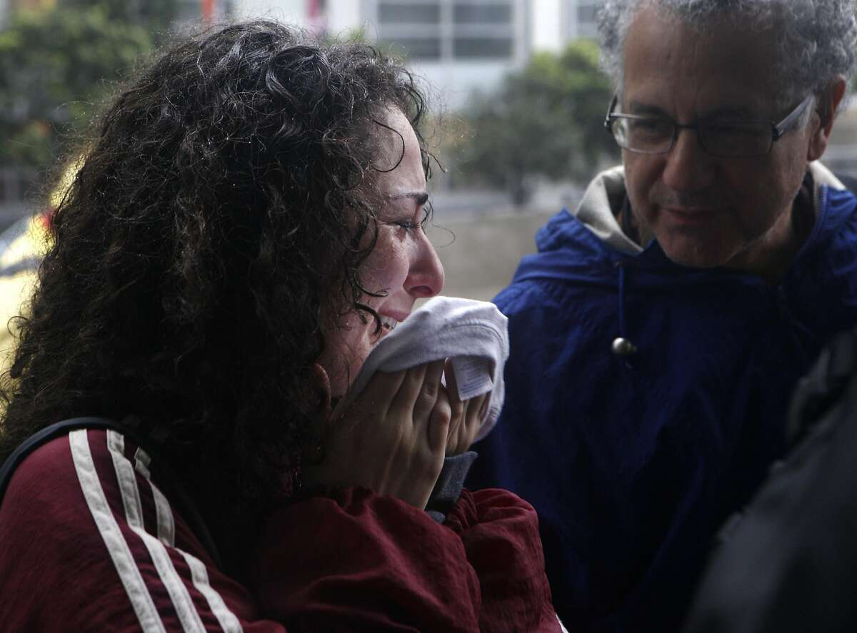 Sasha Zirulnik (left), a member of the local San Francisco community, mourns the loss of Alex Nieto at the San Francisco Federal Courthouse on March 10, 2016 after the verdict of Not Guilty for the federal civil rights trial. The trial covered conflicting versions of what happened when four officers shot and killed 28-year old Alex Nieto at Bernal Heights Park on March 21, 2014.