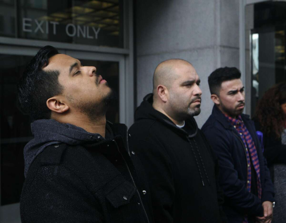 Ely Flores, left, and Oscar Salinas, center, stand outside of the San Francisco Federal Courthouse on March 10, 2016 after the verdict of Not Guilty for the federal civil rights trial. The trial covered conflicting versions of what happened when four officers shot and killed 28-year old Alex Nieto at Bernal Heights Park on March 21, 2014.