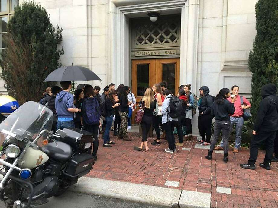 Students from UC Berkeley School of Law deliver a letter of complaint to Chancellor Nicholas Dirks about his handling of accusations of sex harassment against the law school's  dean. Photo: Paul Monge Rodriguez