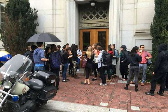 Students from UC Berkeley School of Law deliver a letter of complaint to Chancellor Nicholas Dirks about his handling of accusations of sex harassment against the law school's  dean.