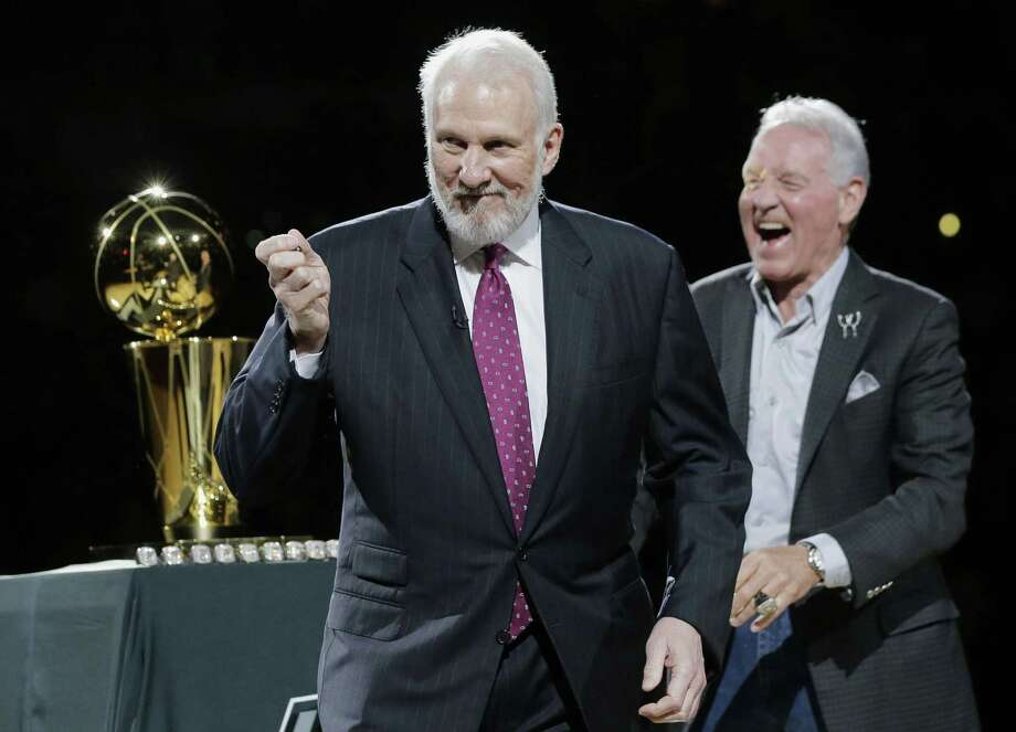 FILE - In this Oct. 28, 2014, file photo, San Antonio Spurs' Gregg Popovich, left, celebrates with owner Peter Holt, right, after they received their NBA championship rings prior to an NBA basketball game between the Spurs and the Dallas Mavericks  in San Antonio. Popovich, who has led the San Antonio Spurs to five NBA titles, will replace Mike Krzyzewski as the U.S. basketball coach following the 2016 Olympics. (AP Photo/Eric Gay, File) Photo: Eric Gay, STF / Associated Press / AP