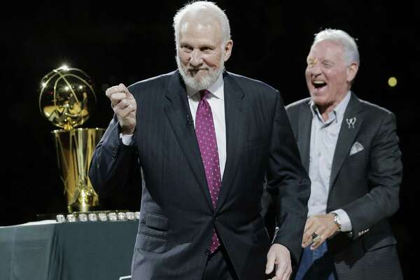 FILE - In this Oct. 28, 2014, file photo, San Antonio Spurs' Gregg Popovich, left, celebrates with owner Peter Holt, right, after they received their NBA championship rings prior to an NBA basketball game between the Spurs and the Dallas Mavericks  in San Antonio. Popovich, who has led the San Antonio Spurs to five NBA titles, will replace Mike Krzyzewski as the U.S. basketball coach following the 2016 Olympics. (AP Photo/Eric Gay, File)