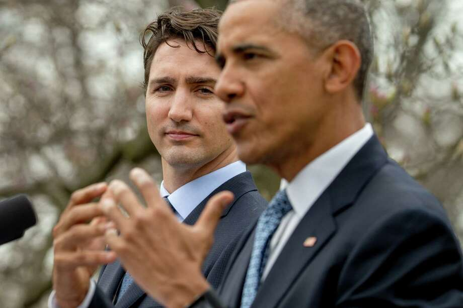 President Barack Obama, accompanied by Canada's Prime Minister Justin Trudeau, announce their joint effort to reduce the emissions of warming gases.  Photo: Andrew Harnik, STF / AP