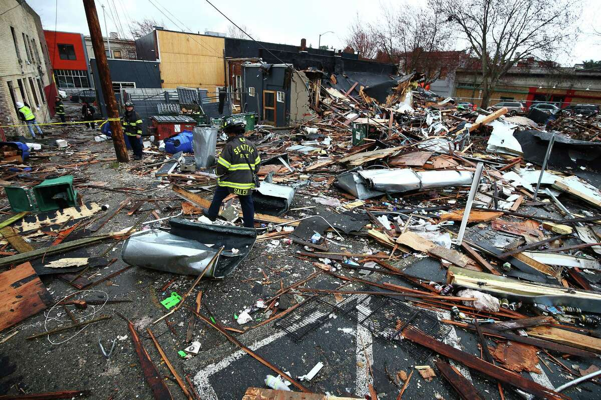 Clean up work continued Thursday, March 10, 2016, at the site of an explosion that leveled three businesses in Greenwood early Wednesday morning.