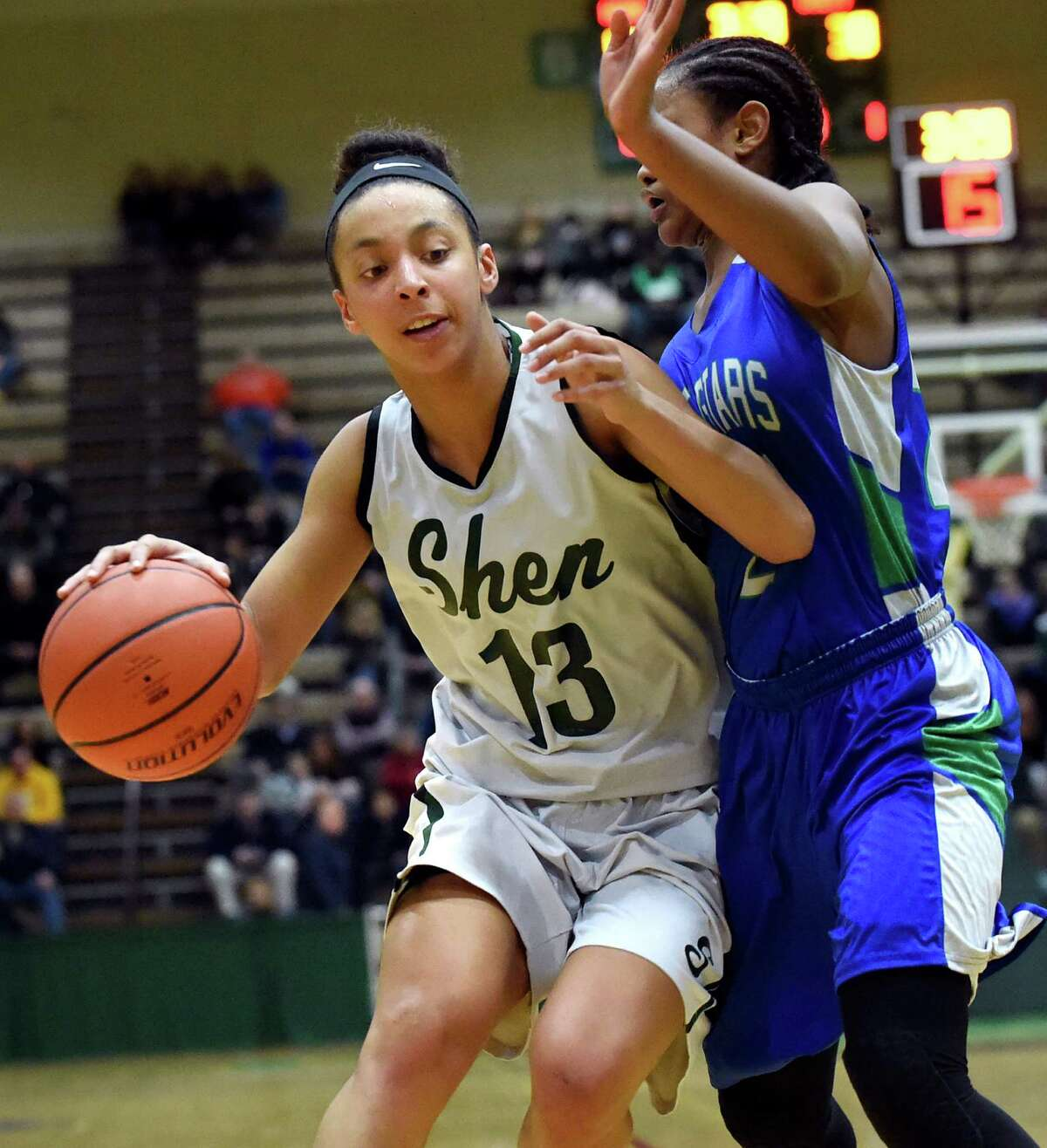 Shen's Sydney Brown, left, works to get past Cicero's Amani Free during their Class AA basketball regional final on Saturday, March 5, 2016, at Hudson Valley Community College in Troy, N.Y. (Cindy Schultz / Times Union)