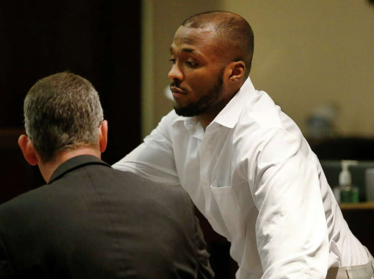 Anthony Lee Smith (right) stands beside his defense attorney, Christian Henricksen, during his murder trial in the 186th State District Court with Judge Jefferson Moore presiding on Thursday, Mar. 10, 2016. Smith is charged with the killing of Daniel Lee Cantu in 2013. (Kin Man Hui/San Antonio Express-News)