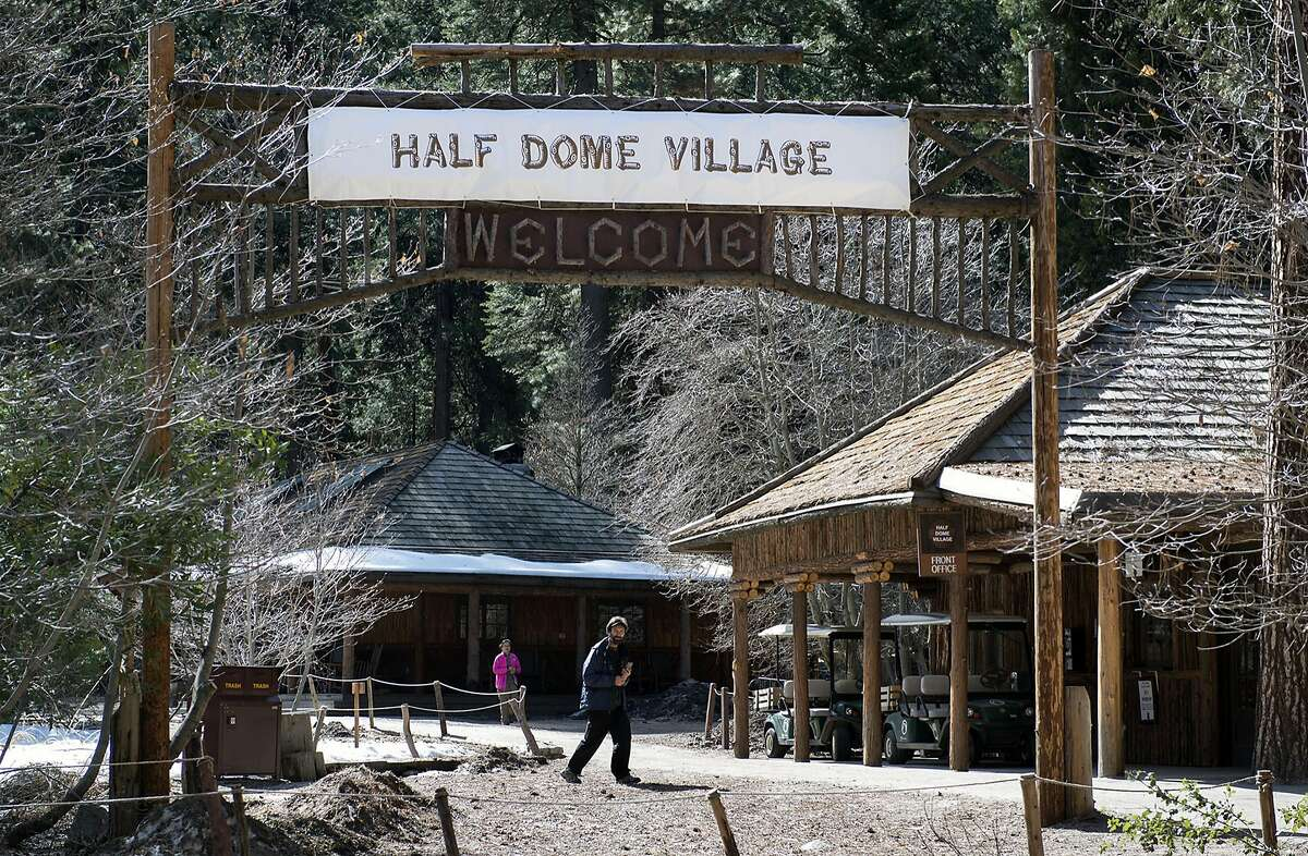 The Curry Village sign has been covered over with a Half Dome Village banner on Tuesday, March 1, 2016, in Yosemite, Calif. (Randy Pench/Sacramento Bee/TNS)