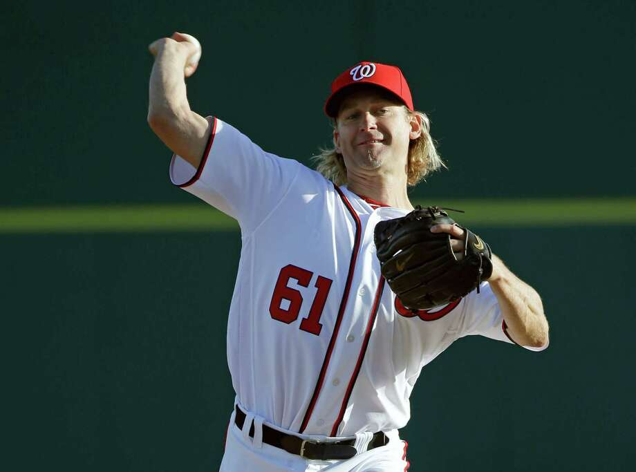 Washington Nationals' Bronson Arroyo pitches against the Houston Astros in the first inning of a spring training baseball game, Thursday, March 10, 2016, in Viera, Fla. Photo: John Raoux, AP / Copyright 2016 The Associated Press. All rights reserved. This material may not be published, broadcast, rewritten or redistribu