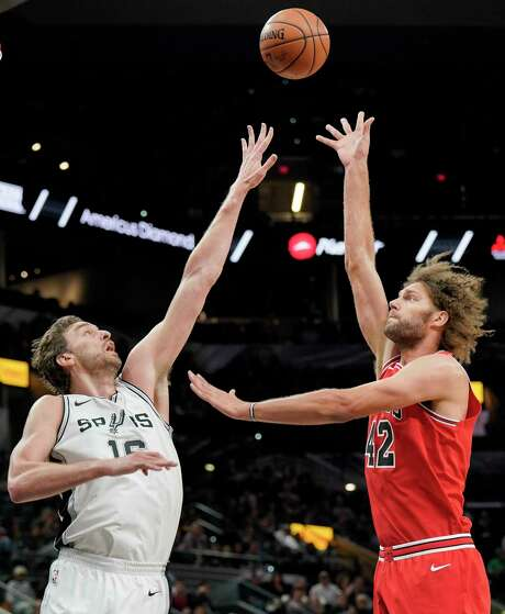 Chicago Bulls center Robin Lopez, right, shoots against San Antonio Spurs center Pau Gasol, of Spain, during the first half of an NBA basketball game, Saturday, Nov. 11, 2017, in San Antonio. (AP Photo/Darren Abate) Photo: Darren Abate, Associated Press / FR115 AP