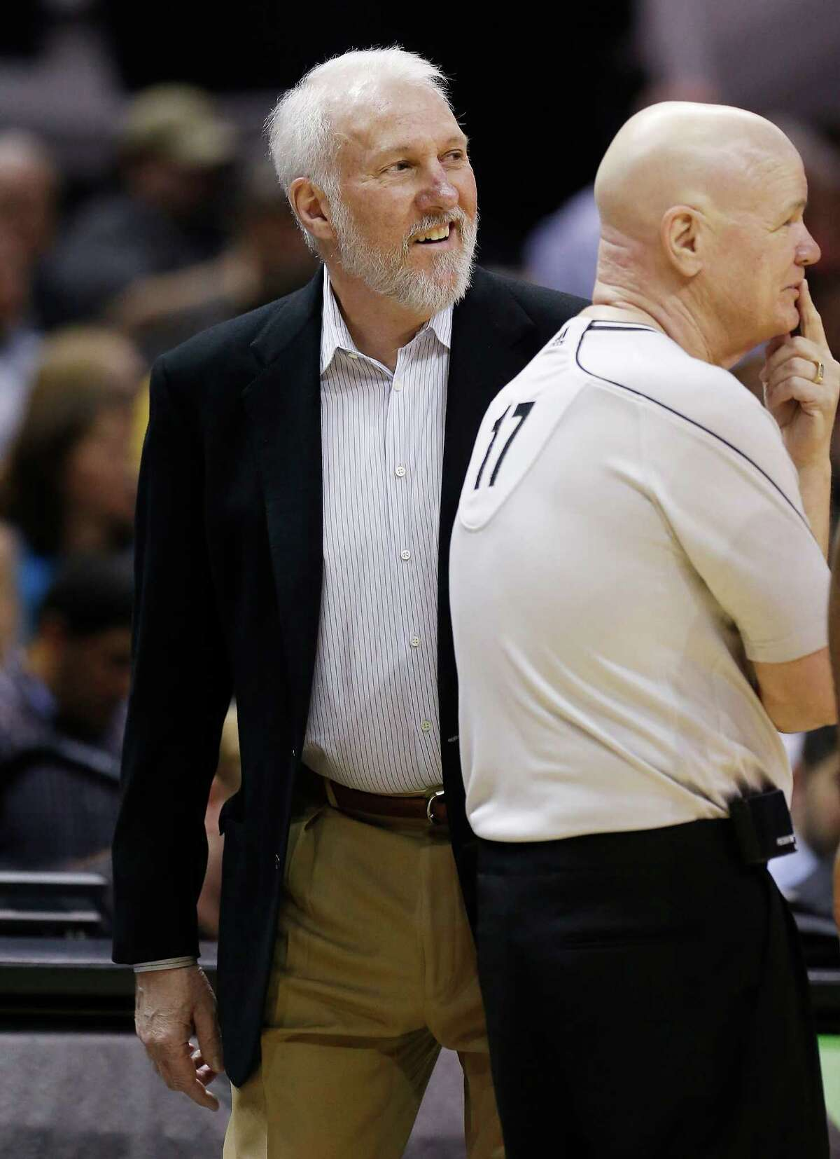 Spurs coach Gregg Popovich smiles beside official Joey Crawford (17) during the game against the Houston Rockets at the AT&T Center on Wednesday, Apr. 8, 2015. (Kin Man Hui/San Antonio Express-News)