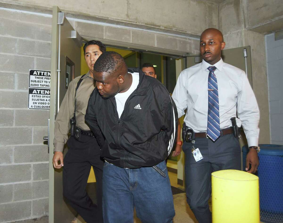 Stephan Wansley is escorted out of Public Safety Headquarters on Thursday, March 10, 2016, after being arrested for aggravated sexual assault in which victims claimed they were lured in with online ads to an abandoned apartment complex and then sexually assaulted.