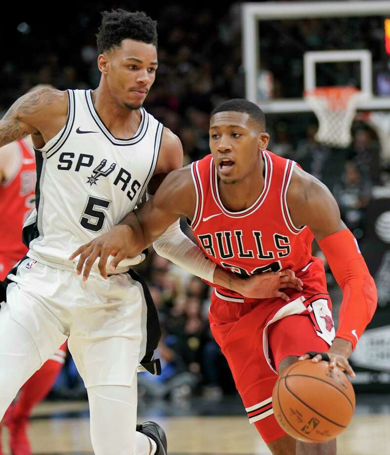 Chicago Bulls guard Kris Dunn, right, drives against San Antonio Spurs guard Dejounte Murray during the first half of an NBA basketball game, Saturday, Nov. 11, 2017, in San Antonio. (AP Photo/Darren Abate) Photo: Darren Abate, Associated Press / FR115 AP