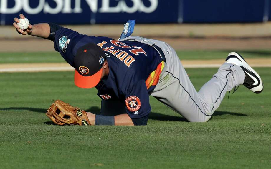Astros third baseman Matt Duffy holds up the ball after making a catch in the second inning of Thursday's game against Washington at Viera, Fla. Photo: John Raoux, STF / Copyright 2016 The Associated Press. All rights reserved. This material may not be published, broadcast, rewritten or redistribu