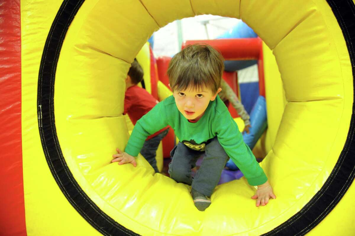 Paul Reach, 3, of Guilderland climbs out of a bounce house during the Purim Carnival on Thursday, March 10, 2016, at Albany Jewish Community Center in Albany, N.Y. The event featured food, games and face painting. Purim is a joyous Jewish holiday that commemorates a time when the Jewish people living in Persia were saved from extermination. (Cindy Schultz / Times Union)