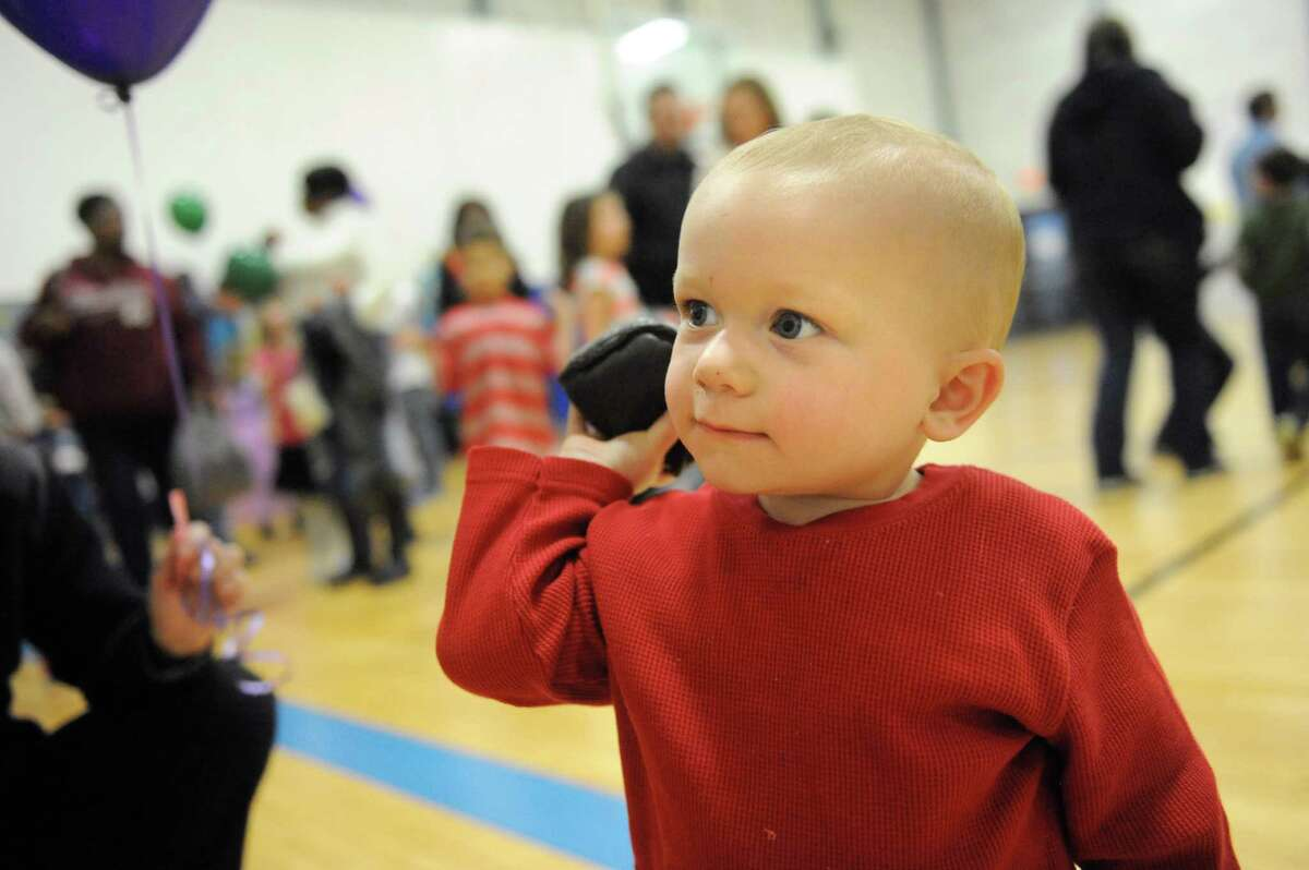 Brady Schools, 20 months, of Delmar readies to throw a bean bag at a carnival game during the Purim Carnival on Thursday, March 10, 2016, at Albany Jewish Community Center in Albany, N.Y. The event featured food, games and face painting. Purim is a joyous Jewish holiday that commemorates a time when the Jewish people living in Persia were saved from extermination. (Cindy Schultz / Times Union)