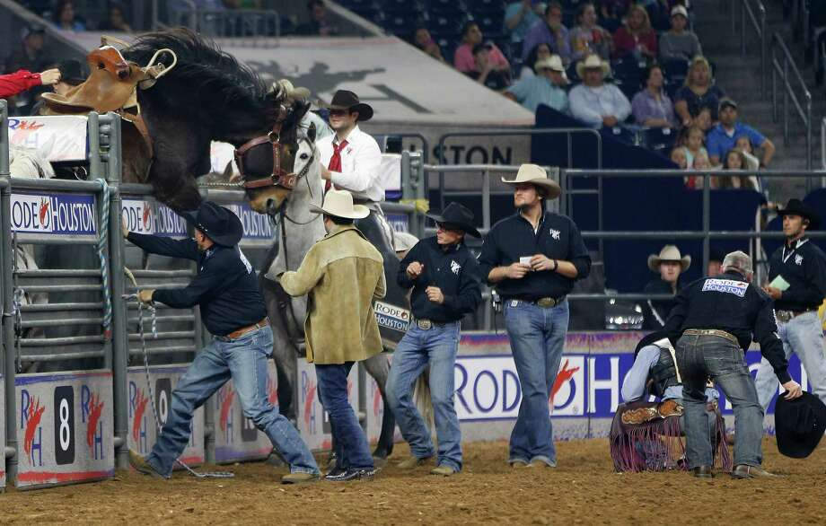 """Cowboy Curtis Garton is tossed out of the chute by """"Simply Marvelous"""" before his saddle bronc ride during round one of the Super Series IV at the Houston Livestock Show and Rodeo at NRG Stadium, Thursday, March 10, 2016. Photo: Karen Warren Karen Warren, Houston Chronicle / © 2016  Houston Chronicle"""