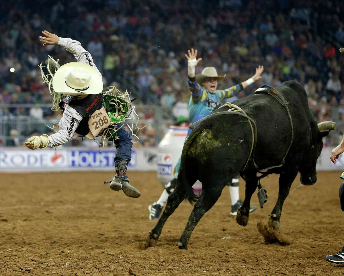 Aaron Pass is tossed off Wild Patch after his ride in the bull riding event during round one of the Super Series IV at the Houston Livestock Show and Rodeo at NRG Stadium, Thursday, March 10, 2016.