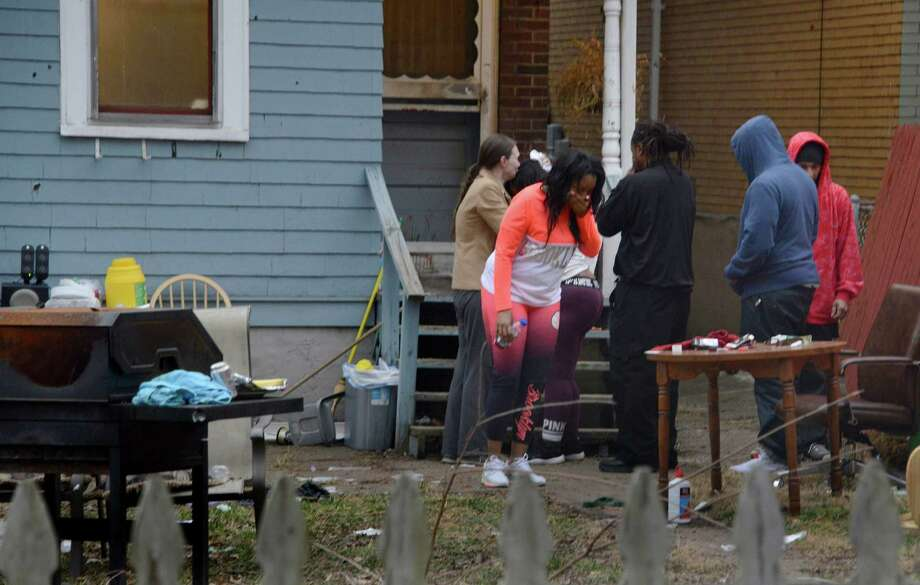 People react in horror to the grisly scene at a  Wilkinsburg, Pa., home where five people were shot to death and three others were wounded. on Thursday, March 10, 2016. This was the site of a shooting late Wednesday that killed five people. (Darrell Sapp/Pittsburgh Post-Gazette/TNS) Photo: Darrell Sapp, MBR / Pittsburgh Post-Gazette