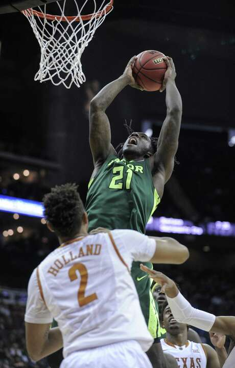 Baylor's Taurean Prince goes up for two of his 24 points against Texas' Demarcus Holland in the second half of Thursday's Big 12 tournament game. Photo: Ed Zurga, Stringer / 2016 Getty Images