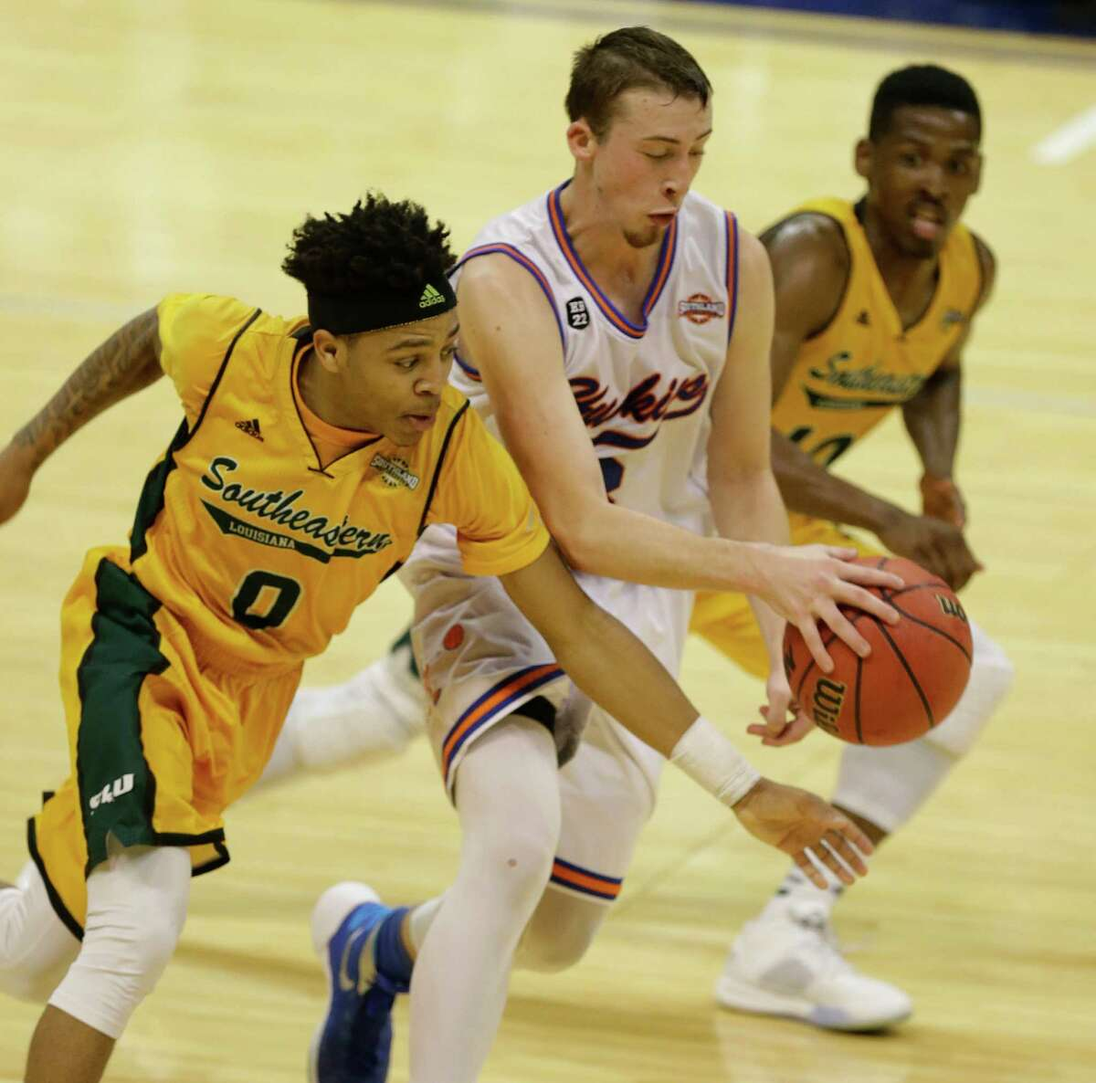 Houston Baptist Asa Cantwell works to control ball against Southeastern Louisiana (0) Marlain Veal and Zay Jackson during the second of game at the Southland conference tournament Thursday, March 10, 2016, in Katy.