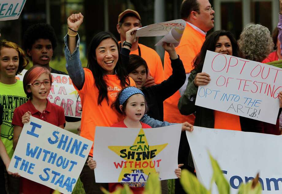 Frustration with standardized testing in schools has increased nationwide. In March 2016, several parents, including Christine Cullen (fist up) and her two daughters Ruby, 10 (left), and Lola, rallied outside Houston school district headquarters to protest. Photo: Steve Gonzales Steve Gonzales / © 2016 Houston Chronicle