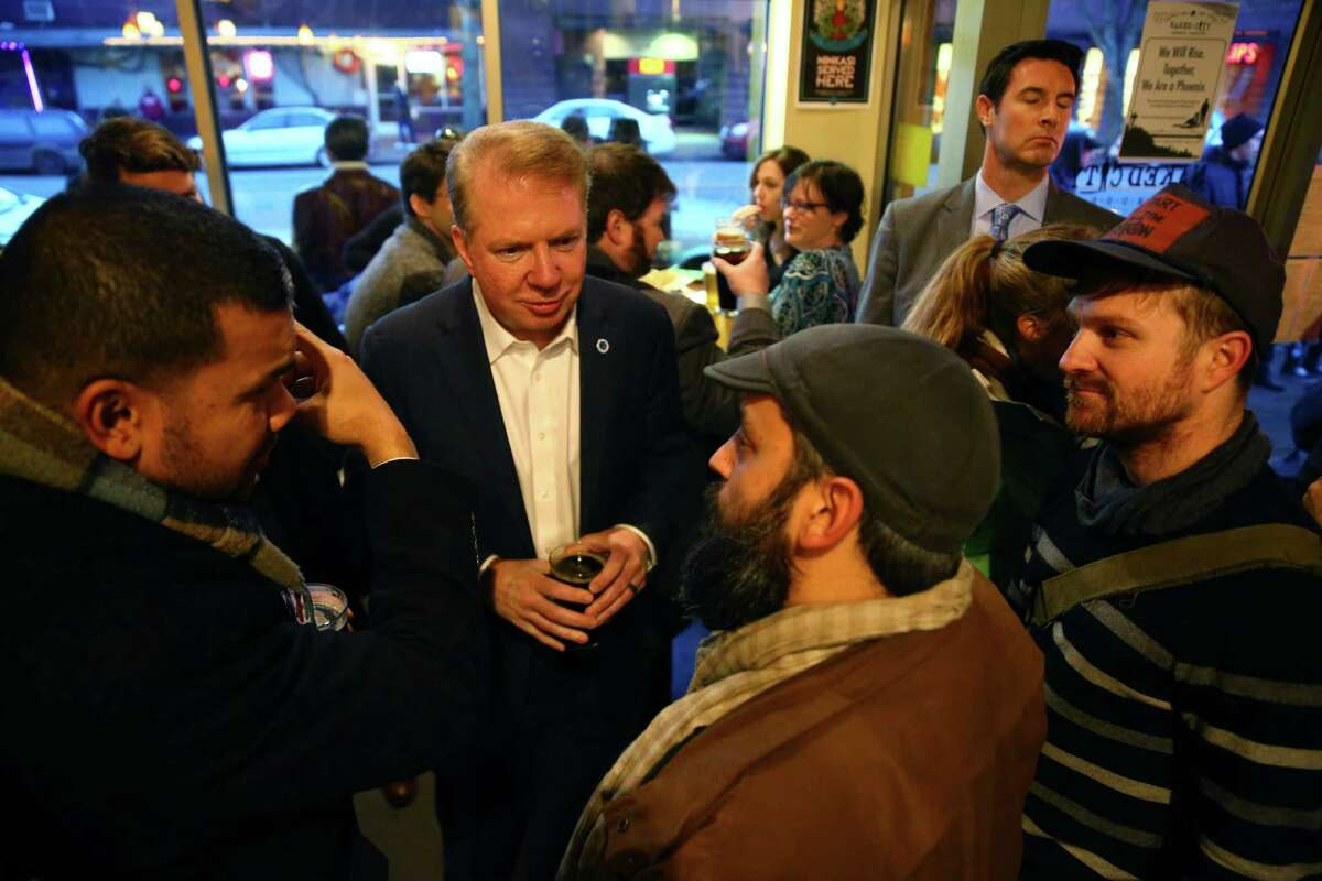 Mayor Ed Murray speaks with David Giuliano and Tyler Gillies whose bike shop G&O Family Cyclery was heavily damaged in the natural-gas explosion, during a fundraiser at Naked City Brewery, Thursday evening, March 10, 2016. One hundred percent of the proceeds from Naked City Brewery's Phoenix Golden Ale went to support businesses affected by the explosion that leveled three business and rocked the Greenwood neighborhood Wednesday morning.