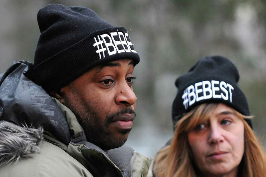 Wayne Best and Karen Kirsch talk about their son as family and friends of homicide victim Wayne L. Best Jr. hold a Christmas tree lighting ceremony at his Vale Cemetery gravesite on Wednesday Dec. 9, 2015 in Schenectady, N.Y.  (Michael P. Farrell/Times Union) Photo: Michael P. Farrell / 10034577A
