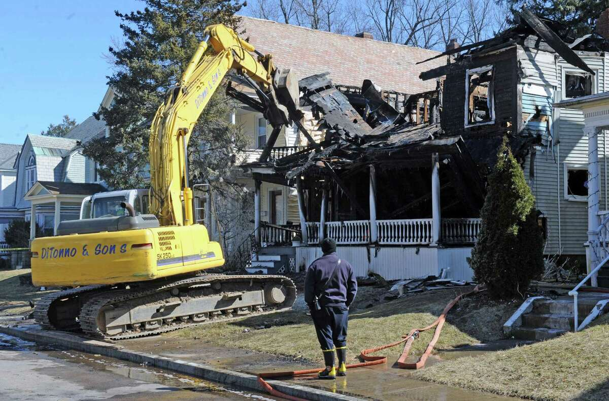 Fire investigators work the scene of a fire at 1052 Parkwood Boulevard on Friday March 4, 2016 in Schenectady, N.Y. (Michael P. Farrell/Times Union)
