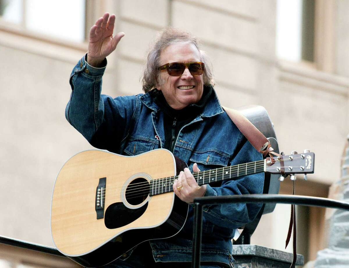 FILE - In this Nov. 22, 2012 file photo, Don McLean rides a float in the Macy's Thanksgiving Day Parade in New York. Patrisha McLean has filed for divorce in Maine. Her lawyer says the legal papers filed Thursday, March 10, 2016, cite ?