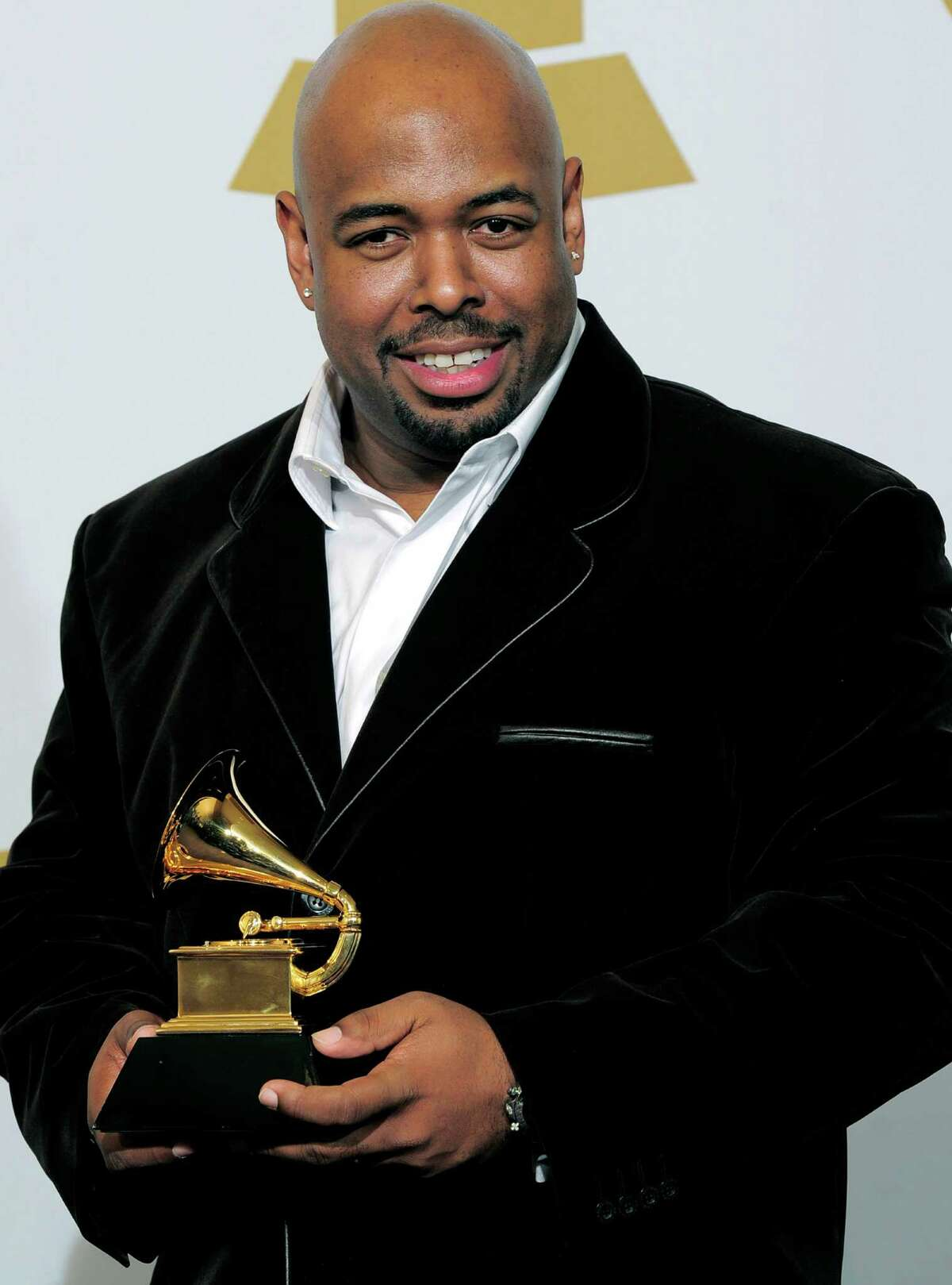 FILE - In this Feb. 12, 2012, file photo, Christian McBride, of the Christian McBride Big Band, poses backstage with the award for best large jazz ensemble for