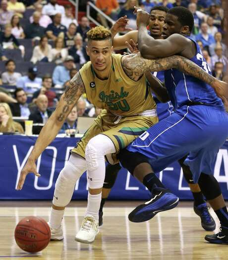 Zach Auguste, who gave Notre Dame 19 points and 22 rebounds, tries to get around Sean Obi, a sophomore who transferred to Duke from Rice. Photo: Ethan Hyman, MBR / Raleigh News & Observer