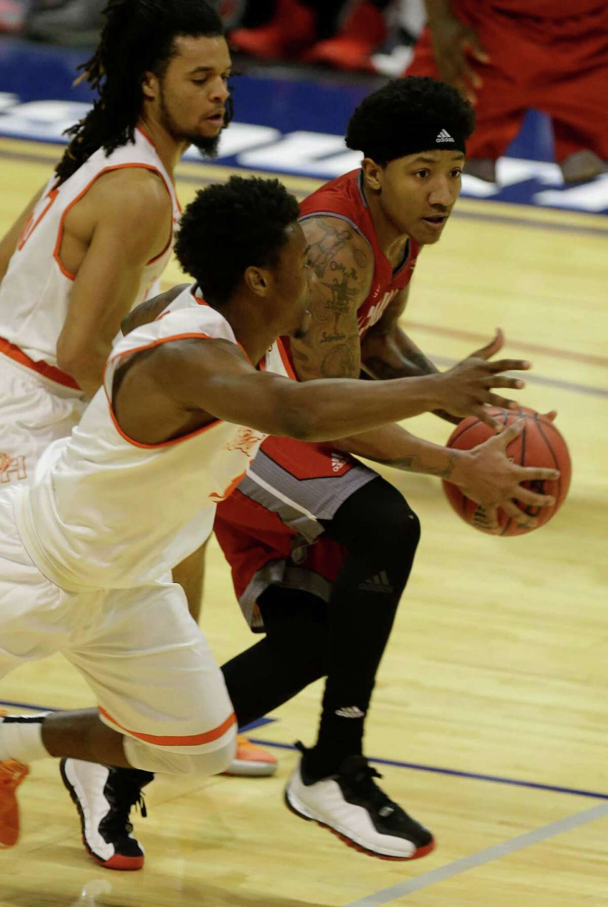 Sam Houston Josh Delandy, left, and Jalin Barnes pressure Nicholls Schane Rillieux during the second half of game at the Southland conference tournament Thursday, March 10, 2016, in Katy.