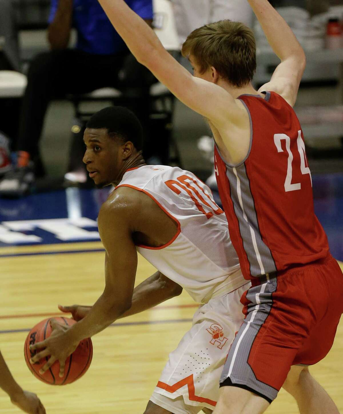 Sam Houston Jamal Williams is guarded by Nicholls Liam Thomas during the second half of game at the Southland conference tournament Thursday, March 10, 2016, in Katy.