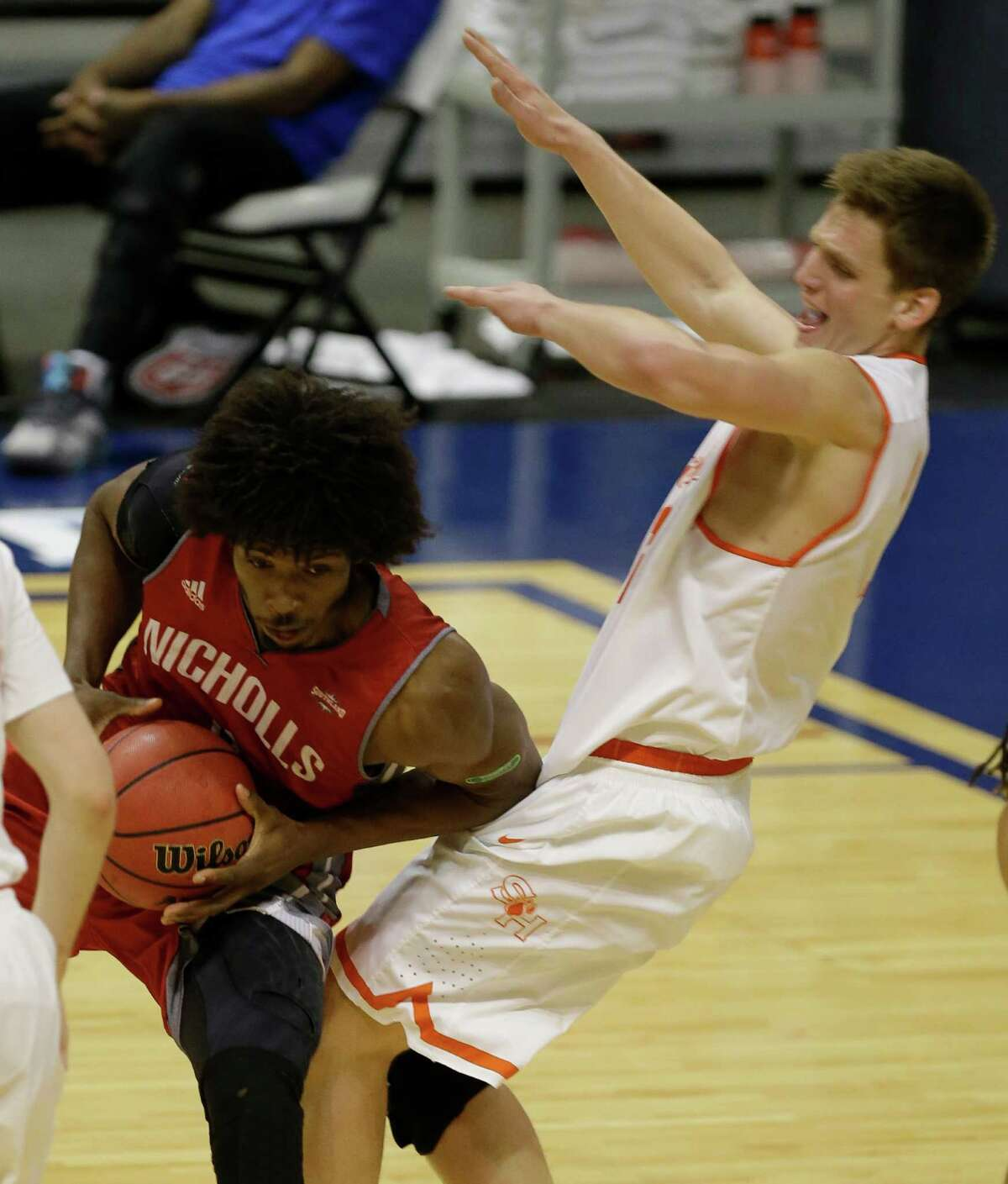Sam Houston Aurimuas Majauskas works to stop Nicholls Adam Ward during the first half of game at the Southland conference tournament Thursday, March 10, 2016, in Katy.
