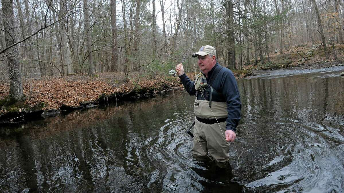 Bob Reichart of Darien, casts a fishing line into the river Thursday at Mianus River Park in Stamford.