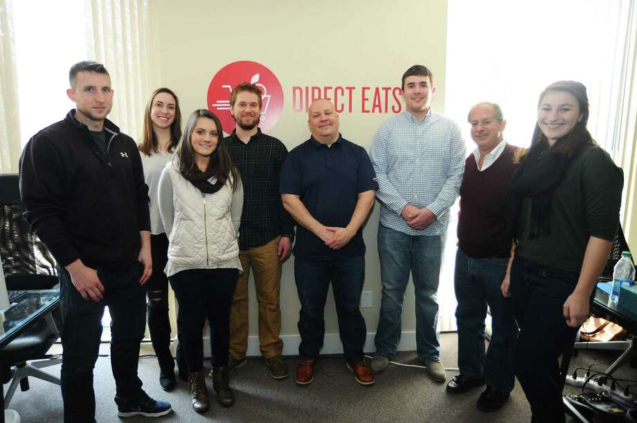 Direct Eats staff, from left, Mike Hart, Sam Goodnow, Jennifer Mager, Dylan Fisher, CEO David Hack, George Wickey, Rocco Strazza and Sam Blau pose in their new Wilton office on Tuesday, March 1, 2016. Direct Eats helps small, specialty food companies reach customers nation-wide. Photo: Michael Cummo / Hearst Connecticut Media / Stamford Advocate