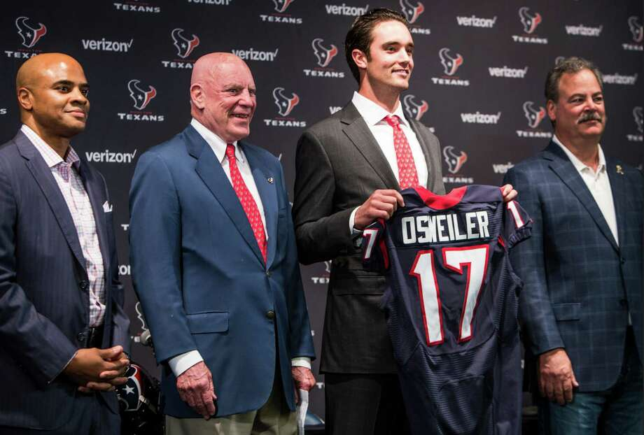 Texans quarterback Brock Osweiler towers over his new bosses: from left, general manager Rick Smith, owner Bob McNair and vice chairman and COO Cal McNair. Photo: Brett Coomer Brett Coomer, Staff / © 2016 Houston Chronicle