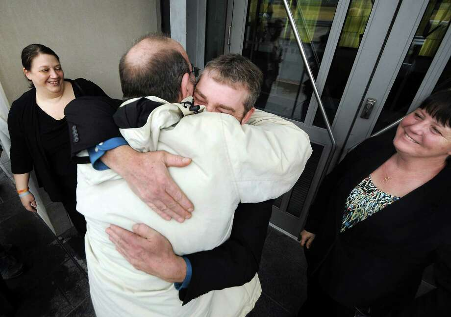 """Dimock Township resident Scott Ely, facing camera, is embraced on Thursday by Raymond Hubert after they and their wives won their cases against Cabot Oil & Gas Corp. in downtown Scranton, Pa. Cabot Oil & Gas says the jury ignored """"overwhelming scientific and factual evidence"""" that the company acted prudently. Photo: Butch Comegys, MBO / The Times & Tribune"""