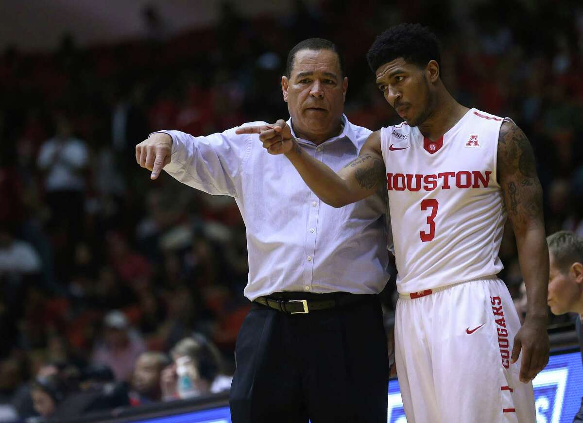 Houston Cougars head coach Kelvin Sampson talks with Houston Cougars guard Ronnie Johnson (3) in the second half of game action against Cincinnati Bearcats at Hofheinz Pavilion on Thursday, March 3, 2016, in Houston. Cougars won 69-56.( Elizabeth Conley / Houston Chronicle )