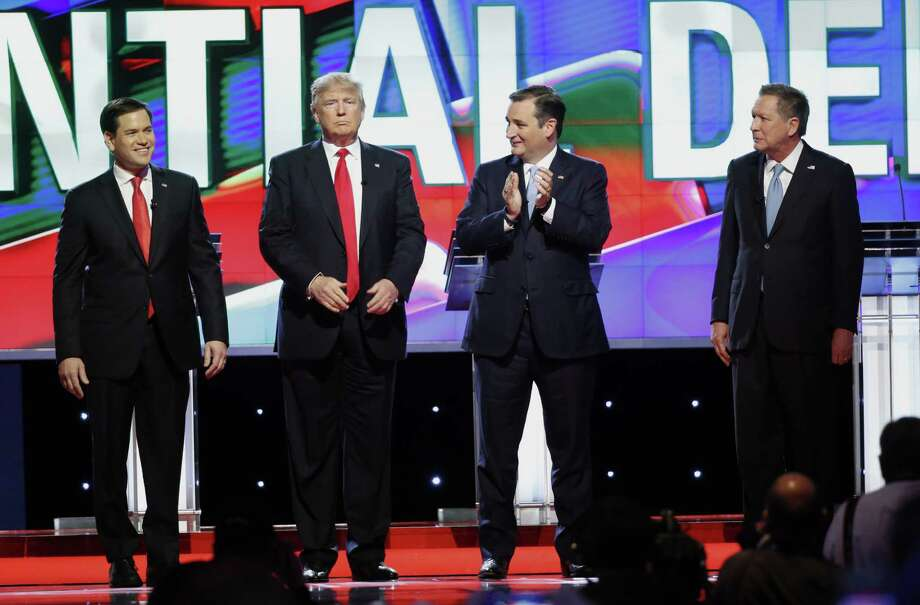 Republican presidential candidates, Sen. Marco Rubio, R-Fla., left, Donald Trump, Sen. Ted Cruz, R-Texas,  and Ohio Gov. John Kasich, right,  stand together before the start of the Republican presidential debate sponsored by CNN, Salem Media Group and the Washington Times at the University of Miami,  Thursday, March 10, 2016, in Coral Gables, Fla. (AP Photo/Wilfredo Lee) Photo: Wilfredo Lee, STF / AP / AP