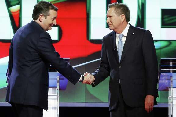Republican presidential candidate, Sen. Ted Cruz, R-Texas, left, shakes hands with Republican presidential candidate, Ohio Gov. John Kasich, at the start of the Republican presidential debate sponsored by CNN, Salem Media Group and the Washington Times at the University of Miami,  Thursday, March 10, 2016, in Coral Gables, Fla. (AP Photo/Wilfredo Lee)